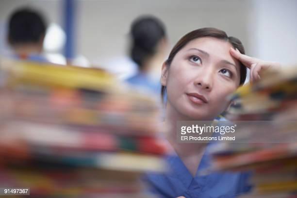 Asian female medical professional thinking