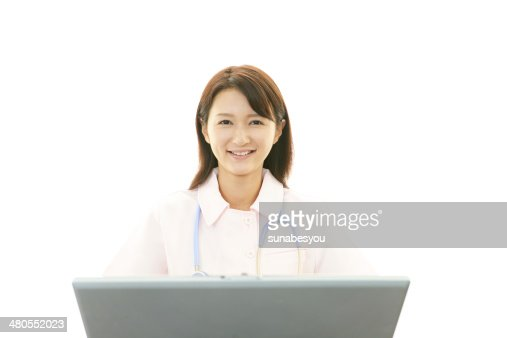 Asian female nurse with laptop computer : Stock Photo