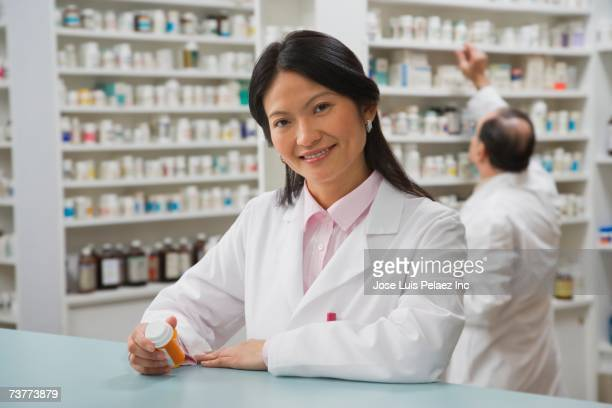 Asian female pharmacist in pharmacy