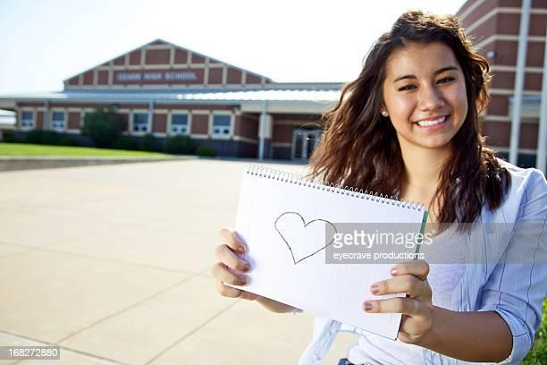 asian female teen at high school entrance
