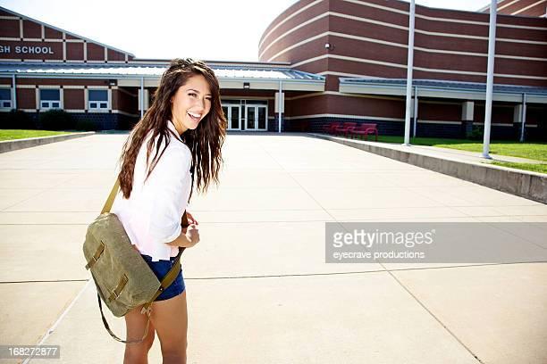 asian female teen at highschool entrance
