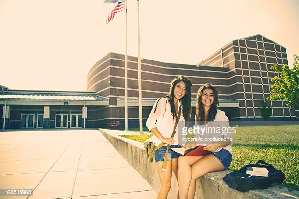 asian female teens at highschool entrance