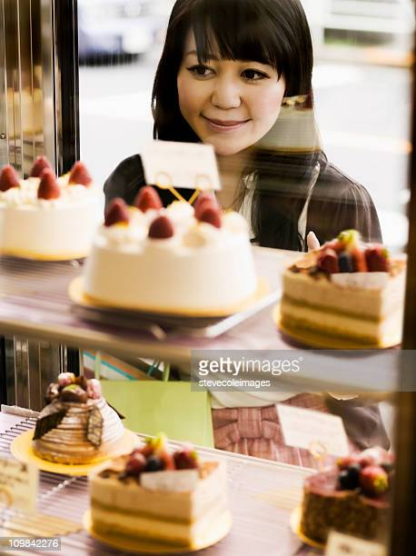 Asian Female Window Shopping for Pastries