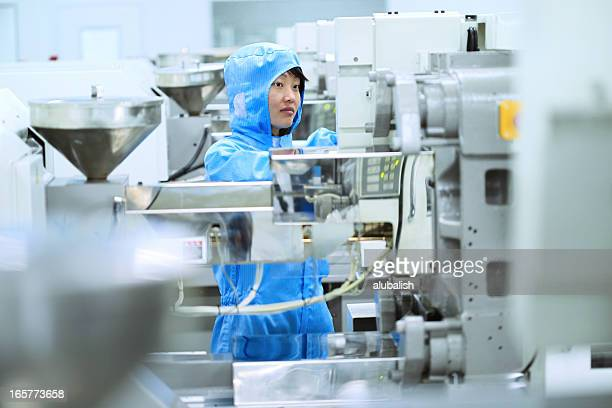 Asian female with factory machine