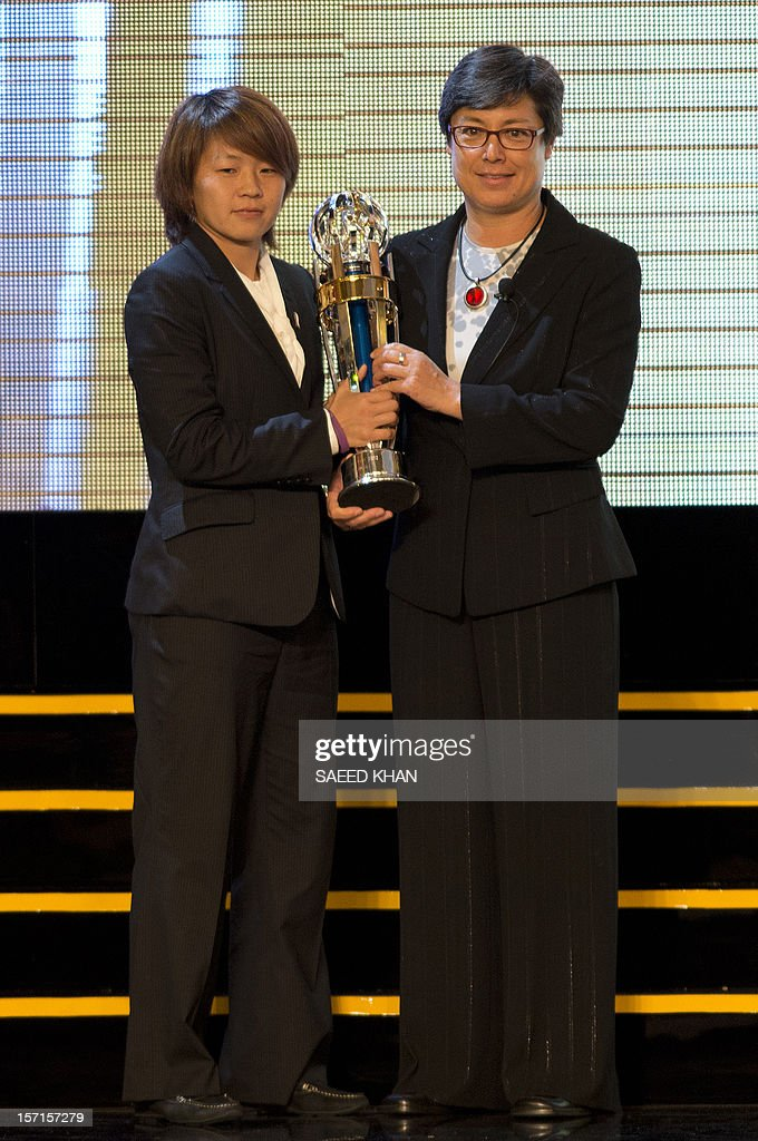Asian Football Confederation (AFC) Women's Player of the Year Aya Miyama (L) of Japan receives the award from AFC vice president Moya Dodd at the AFC Player of the Year ceremony held in Kuala Lumpu...