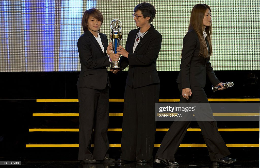 Asian Football Confederation (AFC) Women's Player of the Year Aya Miyama (L) of Japan receives award from AFC vice president Moya Dodd (C) at the AFC Player of the Year ceremony held in Kuala Lumpur on November 29, 2012. Aya Miyama of Japan was crowned Asian Player of the Year at a glittering awards ceremony. AFP PHOTO / Saeed KHAN