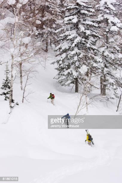 Asian friends walking in snow