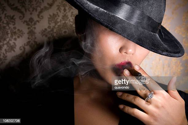 Asian Gangster Woman in Fedora Smoking Cigar with Diamond Ring