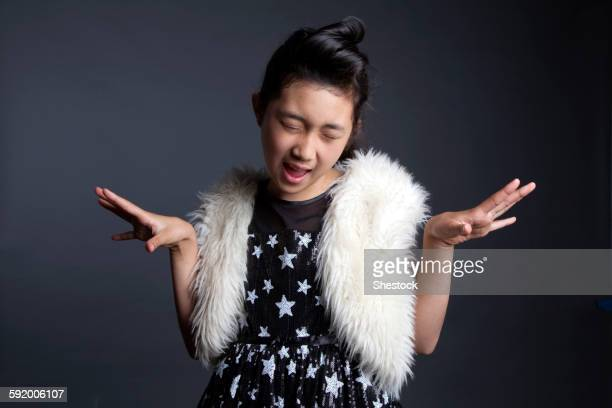 Asian girl dancing in furry vest