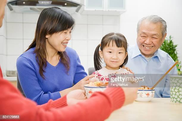 Asian girl having dinner with family