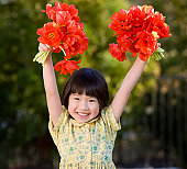 Asian girl holding bouquets of flowers