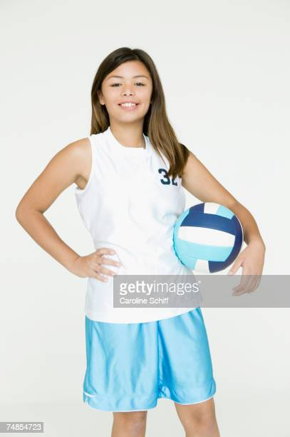 Asian girl holding volley ball