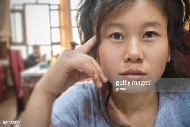 Asian girl in a restaurent.
