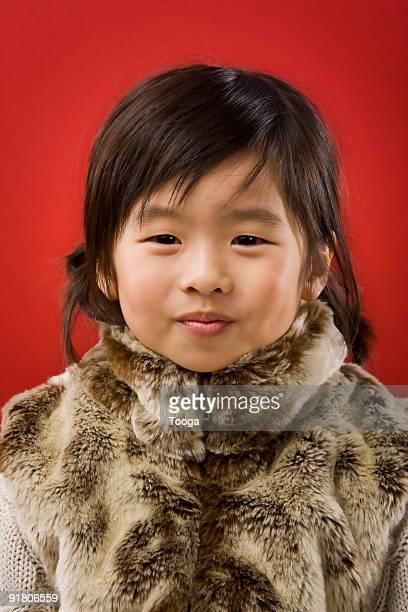 Asian girl in fur coat