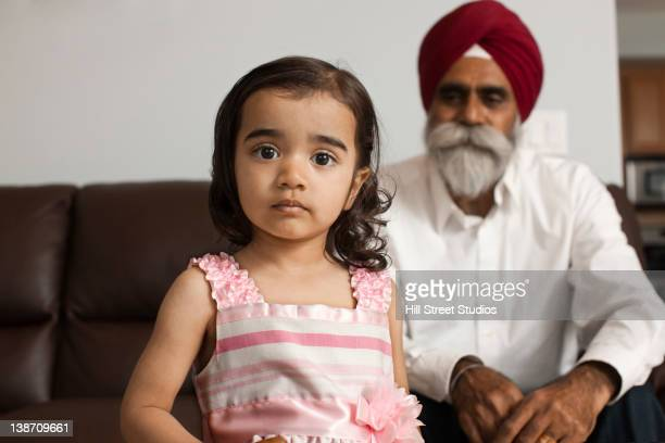 Asian girl in living room with grandfather