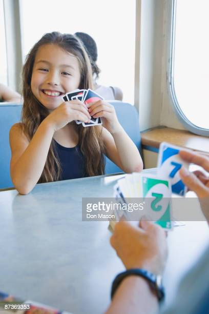 Asian girl playing cards