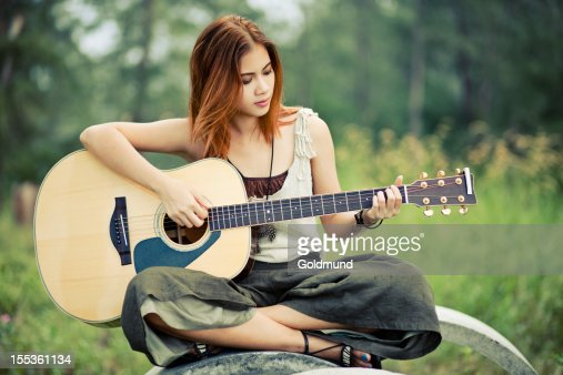 asian girl playing guitar stock photo getty images