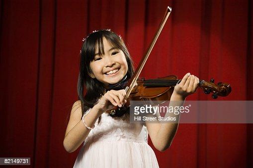 Asian girl playing violin
