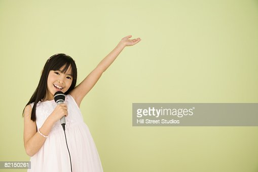 asian girl singing into microphone stock photo getty images