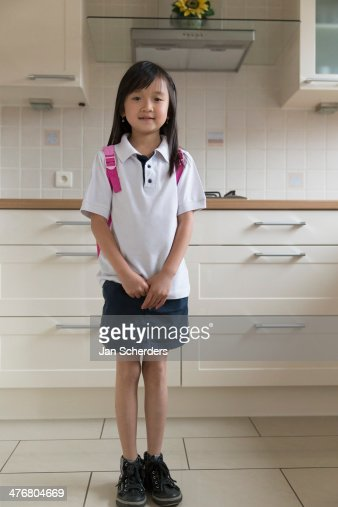 Asian girl smiling in kitchen