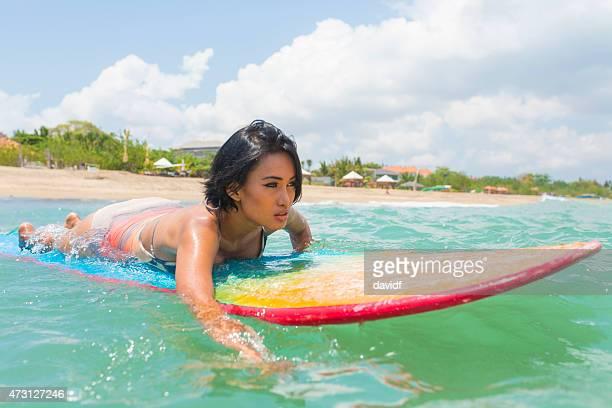 Asian Girl Surfing