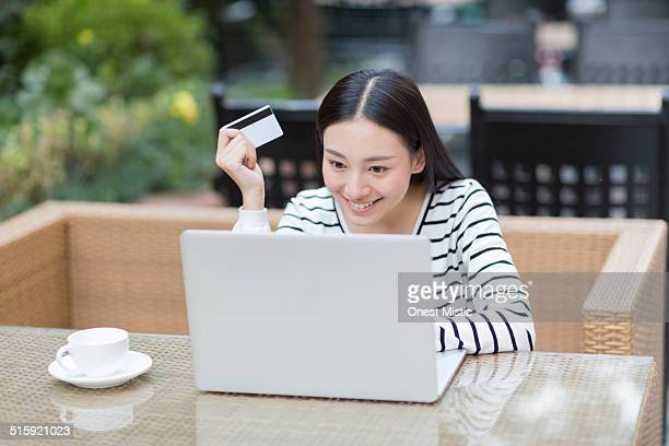 asian girl  using laptop,holding credit card