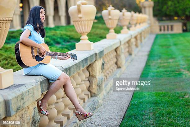 Asian girl with Accoustic Guitar