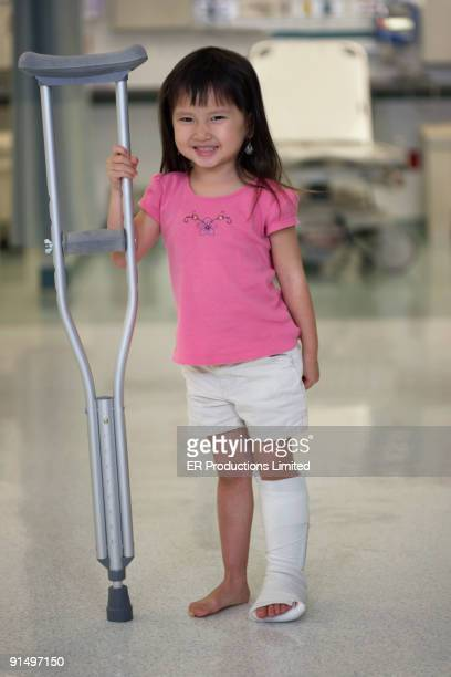 Asian girl with leg in cast