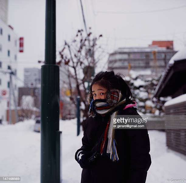 Asian girl with mitten, ear warmer