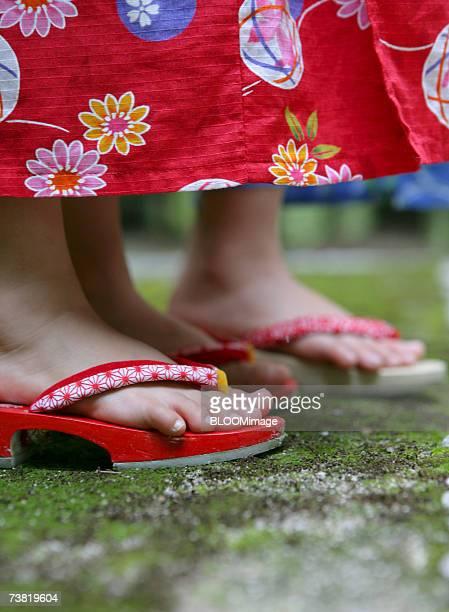 Asian girl's feet, wearing a yukata