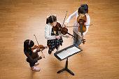 Asian girls playing violins