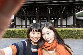 Asian girls who enjoy taking selfie at Tofuku-ji Temple, Kyoto