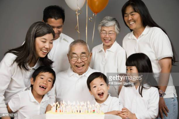 Asian grandfather celebrating birthday with family