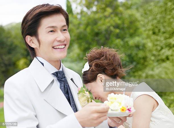 Asian groom having with bride