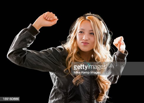 asian hip hop girl dancing and listening to music stock