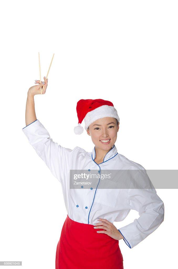 Asian in Santa Claus hats held up chopsticks : Stock Photo
