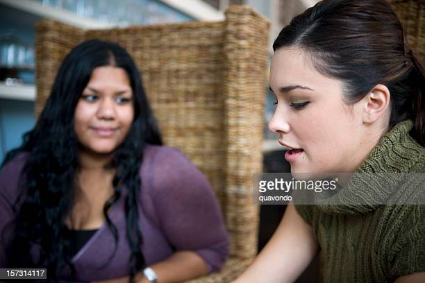 Asian Indian and Caucasian Friends Talking in Coffee Shop
