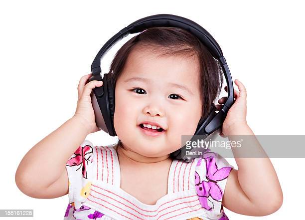 Asian Infant with Headphones