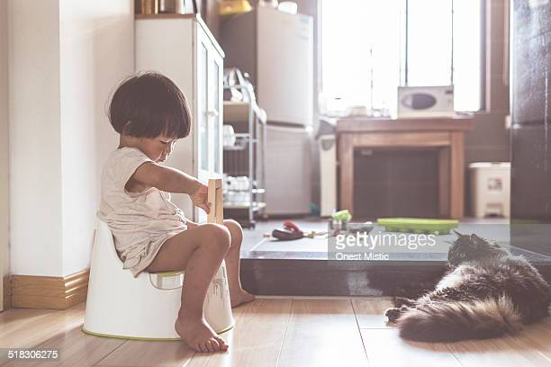 Asian kid with cat at home