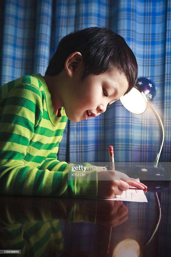Asian kindergarten student doing homework. : Stock Photo