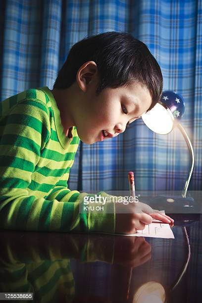 Asian kindergarten student doing homework.