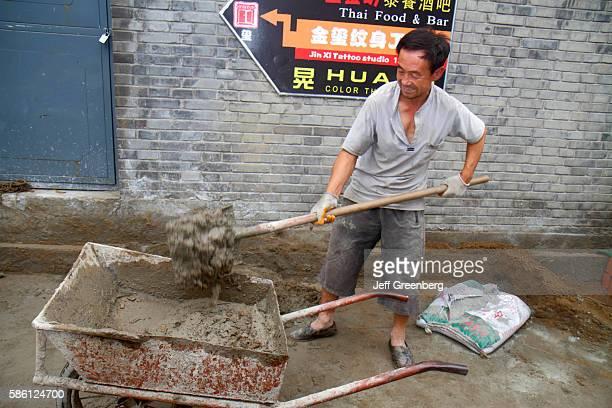 Asian laborer construction worker making cement