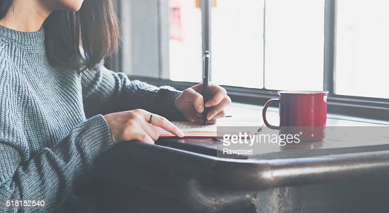 Asian Lady Writing Notebook Diary Concept : Stock Photo