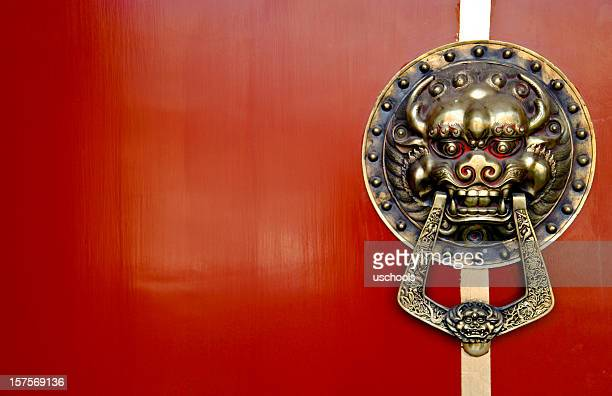 Asian Lion Door Knocker on Red Background