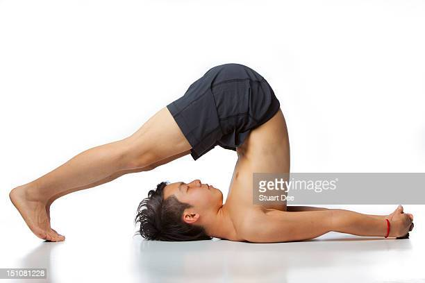 Asian male in yoga pose