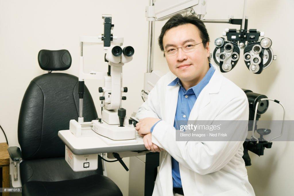 Asian male optometrist in office : Stock Photo
