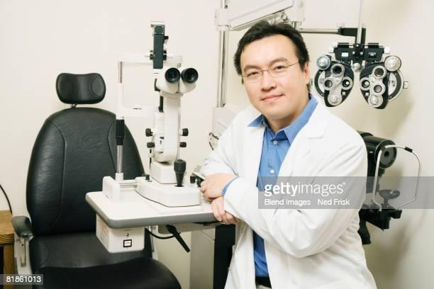 Asian male optometrist in office