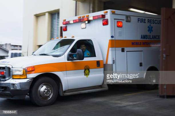 Asian male paramedic driving ambulance