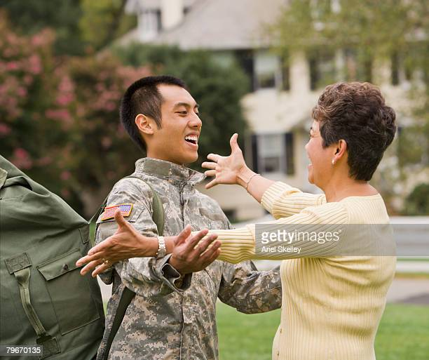 Asian male soldier greeting mother
