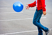 Asian man bouncing ball